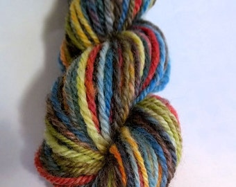 Astral Midnight, handspun washable superwash worsted wool yarn. 78 yds/71 m, 1 oz/30 g