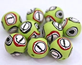 Bright and Happy Set of Polymer Clay Round Beads in Light Pastel Lime Green with Millefiore Cane Slices In Black White and Red