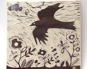 crow flying over garden hand carved ceramic art tile