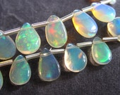 Matching Ethiopian Opal smooth polished teardrop briolette bead pair for earrings