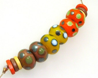 Handmade Lampwork Glass Beads - 3 pairs. Dotties 0n caramel, yellow and orange. Stacked dots, earring pairs, silver black and white, spots.