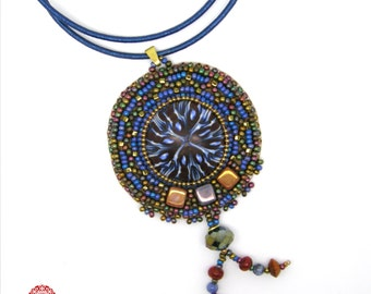 Mandala pendant, bead embroidery around a polymer cabochon, blue, bronze gold, brown