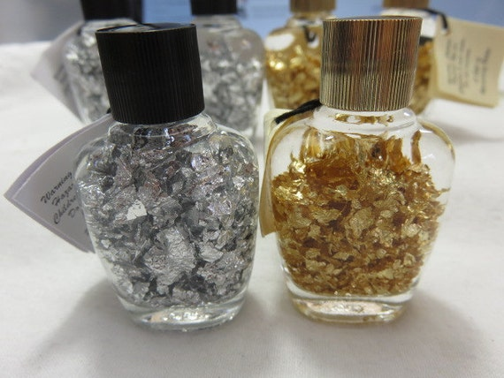Gold Flakes And Silver Flakes In A Bottle Sun Catcher