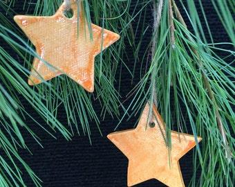 Set of two orange star ornaments