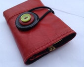 Red leather wallet with lime button