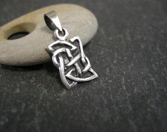 vintage small celtic knot pendant, tiny Irish design pendant or charm, stamped 925, oxidized background