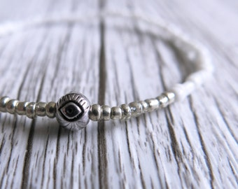 Evil Eye Bracelet   Seed Bead Bracelet   Dainty   Stacking Bracelet   White Silver Beads   Boho Bracelet   Beaded Bracelet  Stretch Bracelet