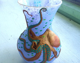 Polymer Clay Copper Octopus with with Teal Tentacles Sculpted onto a Light Periwinkle Vase