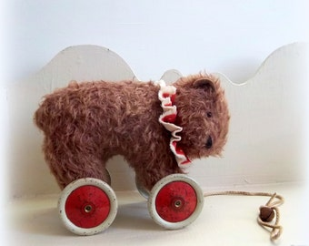 large vintage russet mohair bear on vintage Meccano wheels