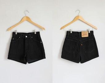 Vintage black denim Levi's high waisted shorts / xs - s - 25w