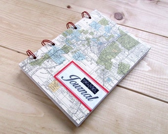 Travel Journal/ Cover with map patterned paper and a Dennison label