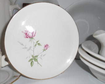 Vintage Shabby Chic Looking Porcelain Plate with pink roses on it