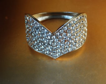 Wedding vintage 80s silvertone metal, hinged, cuff bracelet with a heart shape front, fully covered with a clear rhinestones.Size 6 1/2