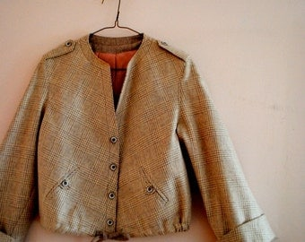 Retro vintage 70s beige plaid wool cropped jacket with a bell sleeve, cinched of the bottom. Made by Coat Fair, LTD. Size 6.