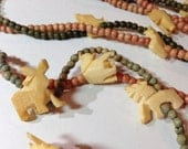Vintage Carved Bone Necklace with Animals and Beads Four Strands