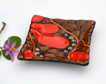 Fused glass art plate, mosaic, dichroic glass beads in gold, black, brown, red, orange stringer, organic.