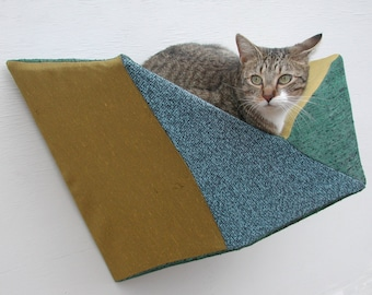 Cat shelf wall bed in teal, evergreen & gold