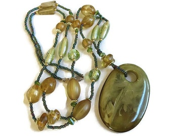 Vintage Large Pendant Necklace with Swirl Greens Lucite and Topaz and Green Lucite Beads