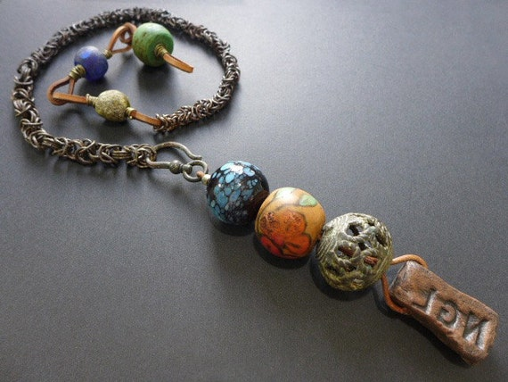 Primate Song. Colorful rustic long pendant lariat choker necklace.