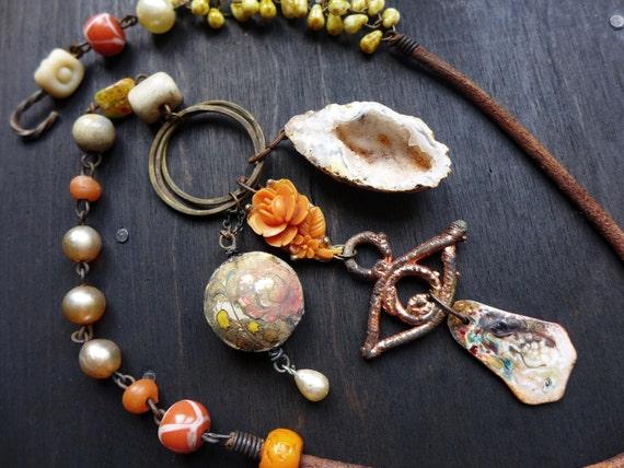 Gaudiloquent. Art bead necklace in primitive cream and orange. Rustic assemblage jewelry.