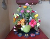 Spring mix floral arrangement in green container