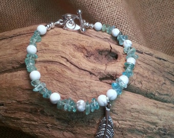 Gemstone bracelet, hand beaded , Apatite and Howlite ,Qwl toggle and feather charm,79