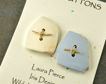 Square pair     two whimsical naturally ocean smoothed  cream and light blue  square sea pottery buttons from the coast of Maine