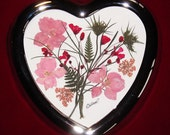 Valentine flowers pressed in a silver-tone heart frame