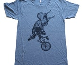 Triceratops on a BICYCLE  tri-blend athletic blue T-Shirt