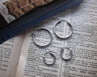 Two pairs of Sterling Silver latch hoop earrings