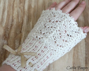 Soft and elegant wrist warmers, hand knit of luxery yarns. 50% camel/silk with glass beads