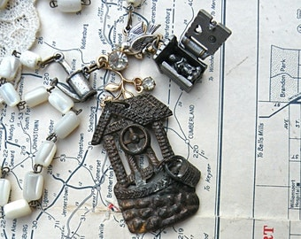 outdoors necklace assemblage object charm mother of pearl wishing well outhouse