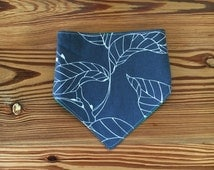 Grey Botanical handkerchief bib with green backing with metal snaps