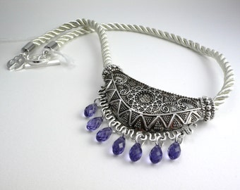 Purple swarovskis pendants on rope.