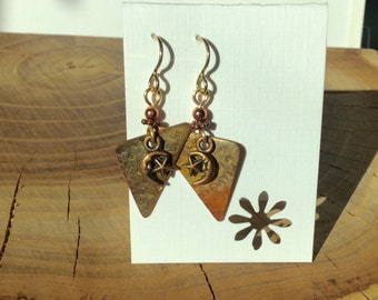 Repurposed roofing earring with moon and stars charm.