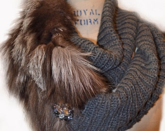 Gray knit infinity scarf with a fur twist