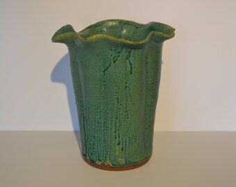 Turquoise green/blue fluted vase.