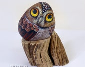 Owl hand painted on a river stone. One of a kind artwork.