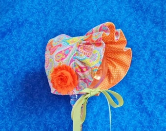 Tangerine Baby Bonnet with Paisley Reversible Bonnet to Orange and White Polka Dots
