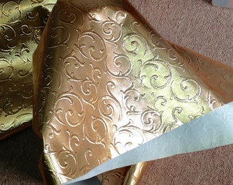 TL16.  Embossed Gold Foil Leather Cowhides