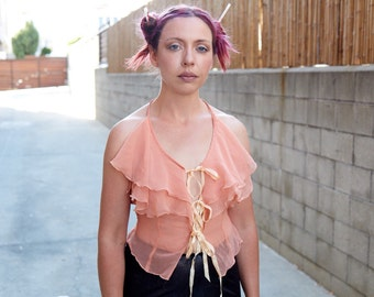 1970s glam rock ruffles and ribbons peach blouse