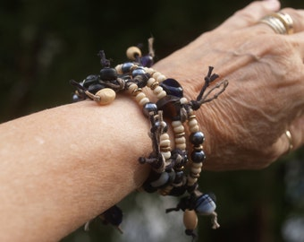 Bracelet made of Three Black & Beige Knotted Hemp Strands Woven Together with Glass and Wood Beads and Gold Tone Metal Findings
