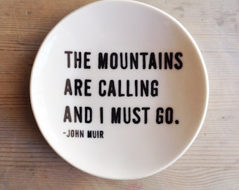 porcelain dish screenprinted text the mountains are calling and i must go. -john muir