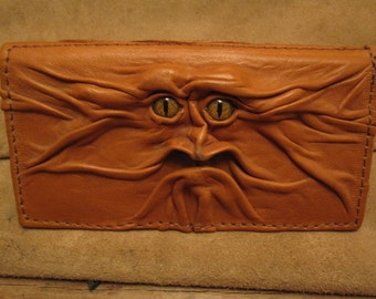 "Grichels leather checkbook cover - ""Vunwid"" 26577 - caramel brown with gold speckled slit pupil reptile eyes"