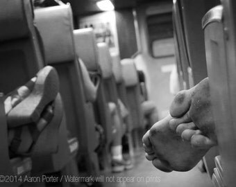 Last Train, Saturday Night (Tired partier with dirty bare feet sleeps on train)