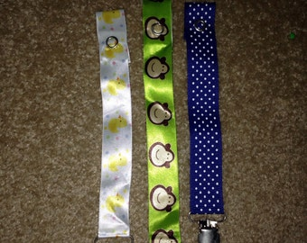Pacifier holders with rings