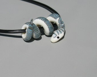 SALE Turquoise and Ivory Snake Glass Lampwork Bead on black cord necklace in gift box
