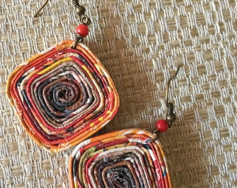n. 63 ORANGE & red ROUND coiled recycled paper pierced earrings with glass beads measure 1.25""