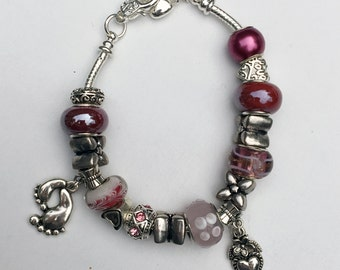 "European Style Bead Bracelet , Pink, Mauve ""Hugs and Kisses"" with Heart and Baby feet Charms, Silver Spacers"