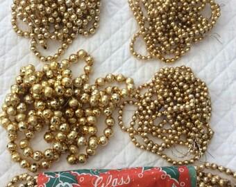 Five Strands Vintage Gold Glass Garland